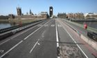 Westminster Bridge, next to the Houses of Parliament and Big Ben, is almost deserted during lockdown.