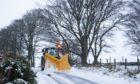 A plough clears snow near Cushnie in Aberdeenshire.