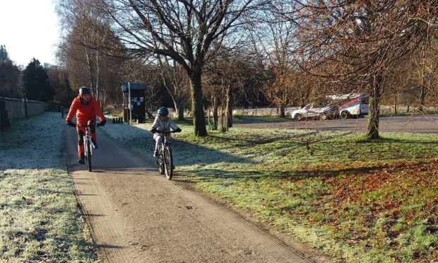 Cyclists on the Speyside Way in Aberlour.