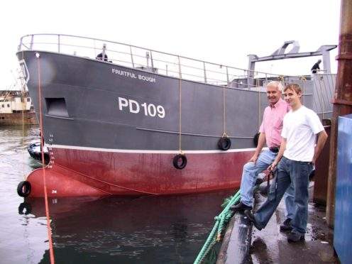 The late James West, with son Andrew and Fruitful Bough at Macduff Harbour in 2003. Photo by Andrew Taylor, Banff.