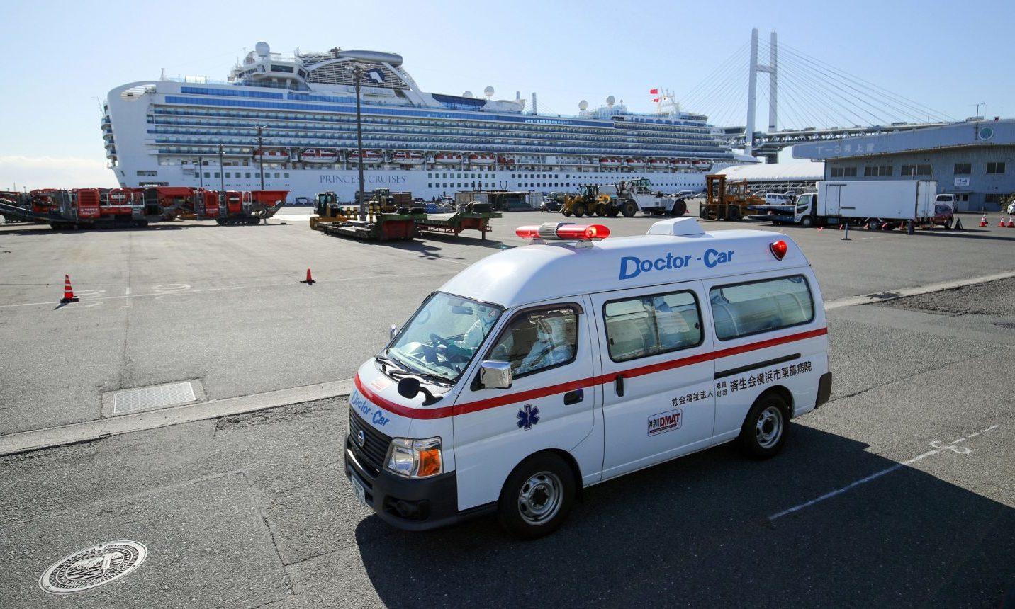 An ambulance believed to carry a Diamond Princess cruise ship passenger infected by the coronavirus leaves the Daikoku Pier Cruise Terminal in Yokohama, Tokyo.