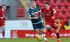 Aberdeen midfielder Scott Wright and Motherwell's Robbie Crawford.