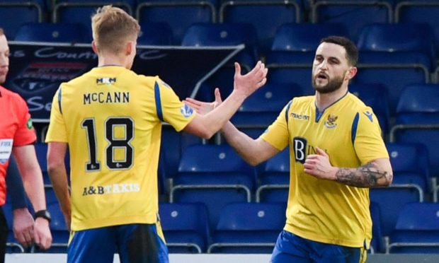 St Johnstone's Craig Conway (R) celebrates making it 1-1 with Ali McCann during the Scottish Premiership match between Ross County and St Johnstone at the Global Energy Stadium.