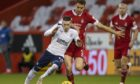 Rangers' Ryan Kent (left) tussles with Aberdeen's Tommie Hoban.