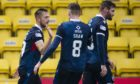 Charlie Lakin, left, celebrates netting for Ross County.
