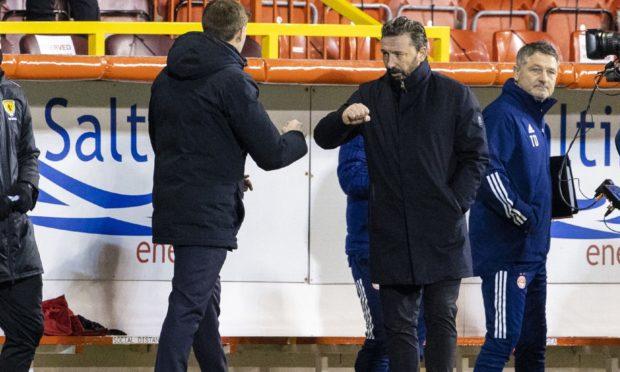 Rangers manager Steven Gerrard (left) with Aberdeen manager Derek McInnes.