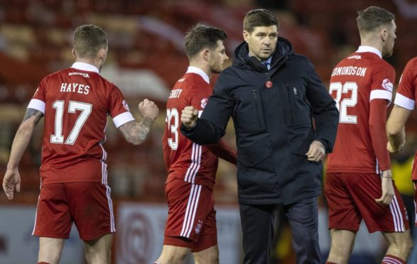 Rangers manager Steven Gerrard (right) with Jonny Hayes at full time in the match between Aberdeen and Rangers.