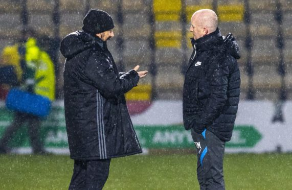 Derek McInnes and David Martindale speak before kick-off was due to take place.