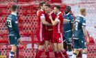 Aberdeen's Tommie Hoban (centre) celebrates making it 1-0
