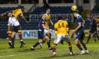 Bevis Mugabi nods home for Motherwell against Ross County.
