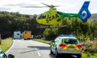 Scotland's Charity Air Ambulance (SCAA) touching down at the scene at Elphin.