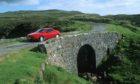 Visitors at the Fairy Bridge on Skye
