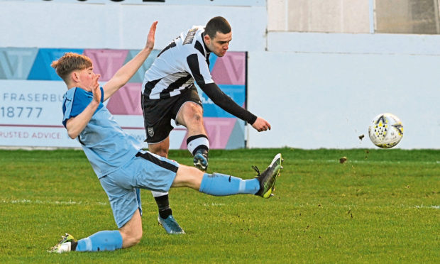 Scott Barbour scores against Turriff United for Fraserburgh as the Broch ran out 13-1 winners. Picture by Jason Hedges
