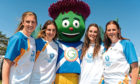 From left, Queen's Baton bearers Sarah Dunnett, Emma Dunnett, Oonagh Dunnett and Sophie Dunnett, all from one family, from Thurso, with Clyde - the official mascot for Glasgow 2014 - in Brora.