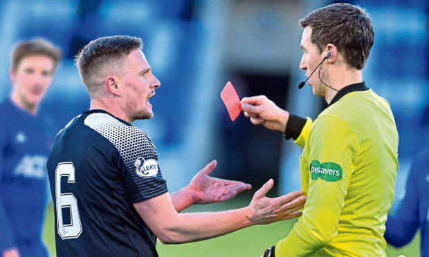 Peterhead's Simon Ferry is shown a red card against Cove Rangers. Picture by Chris Sumner