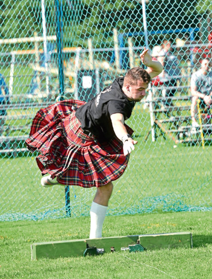 George Evans throws the 16lb stone at Aboyne Highland Games. Picture by Colin Rennie