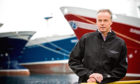 Ian Gatt chief executive of the Spfa, at Fraserburgh Harbour with pelagic fishing boats.