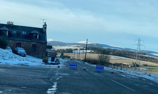 Police close the road near Paterson's Stoves, B9119.. Aberdeenshire.
