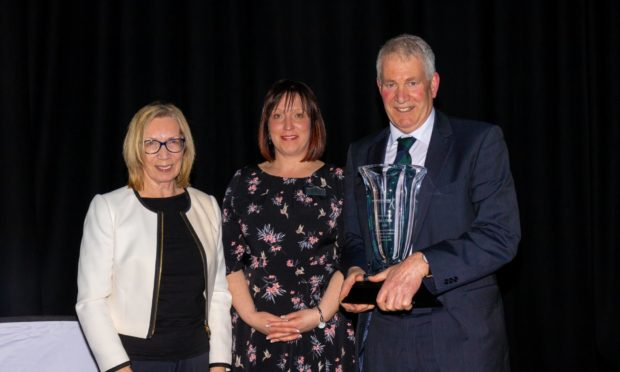 L - R: Lorna Conn; Jackie Smith - Chair of Aberdeenshire Clubsport SCIO, Jim Conn - Founding Chair Aberdeenshire Sports Council, who was presented with a special award for over 30 years within sports council in Aberdeenshire.