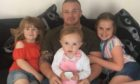 Scott Cowie and, left to right, daughter Wynter, daughter Lotti, and step-daughter Sophie.