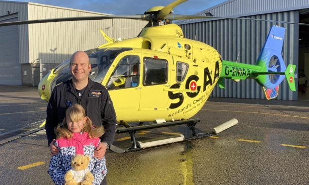 Arabella Winn has encouraged her classmates to help fund teddy bears for her air ambulance pilot father to give to seriously sick or injured children.