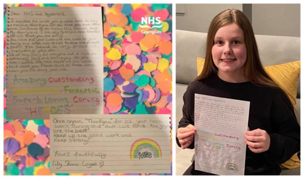 Lily Shaw with her letter to the NHS.