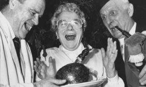 Tibby Main, one of the residents at Mark Bush Court, Kincorth, is obviously enjoying herself as she addresses the haggis at the court's Burns Supper in 1990. Aiding and abetting are chef John Wilson and piper Gordon Luke,