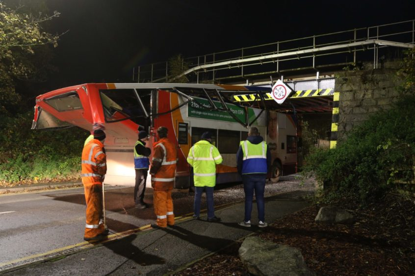 Rail services in and out of Inverness were disrupted in November 2019 after a Stagecoach double decker bus went under a low bridge on Harbour Road and sliced the top deck off. Nobody was injured in the crash. Picture by Andrew Smith