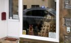 Dave the Dalek stands watch at the Dufftown Glassworks store.