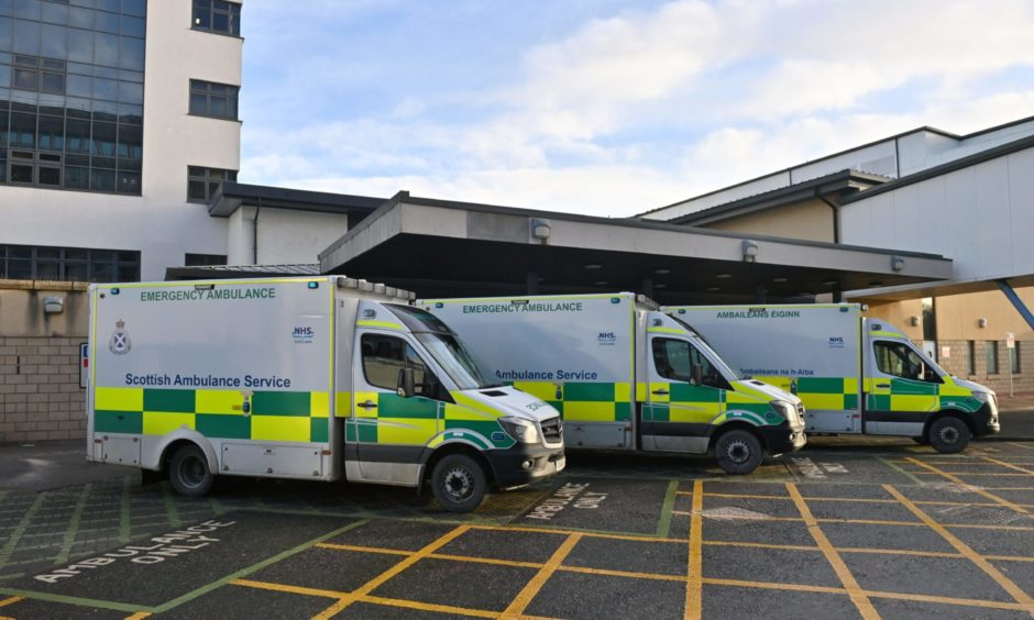 Ambulances outside the Aberdeen Royal Infirmary (ARI) emergancy door.  Picture by Kenny Elrick     27/12/2020