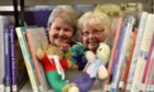 Councillors Anne Stirling and Anne Simpson with some bears knitted by the Live Life Aberdeenshire libraries knit and natter groups.