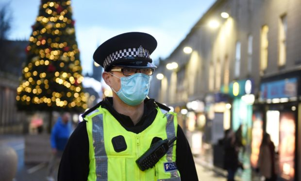 Police responded to more than 80 reports of Covid rule breaches in Aberdeen on Hogmanay.