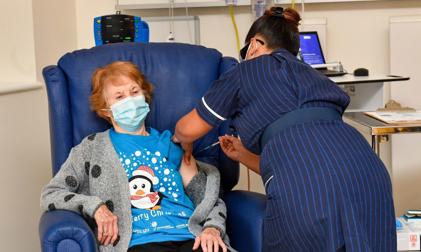 Margaret Keenan, 90, is the first patient in the United Kingdom to receive the Pfizer/BioNtech covid-19 vaccine at University Hospital, Coventry, administered by nurse May Parsons.