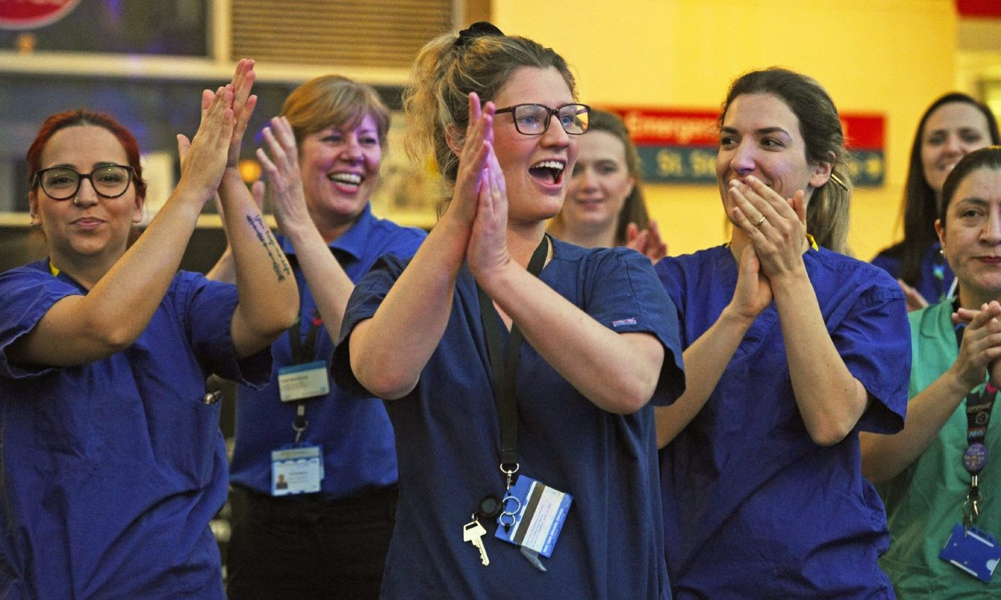 Hospital staff in London take part in the Clap for Carers initiative to applaud NHS workers fighting the coronavirus pandemic.