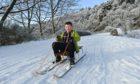 Kyle Saxton sledges at Craigellachie Bridge. More snow is forecast for the Highlands.