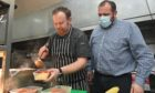 Free school meals prepared at 156 Bar & Grill. Pictured: Chef Barry Milne and co-owner Paul Davies.