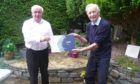 John MacKenzie, chairman of Badeoch Shinty Memories (left) recently received a laptop from Donnie Grant, Shinty Memories Scotland ambassador