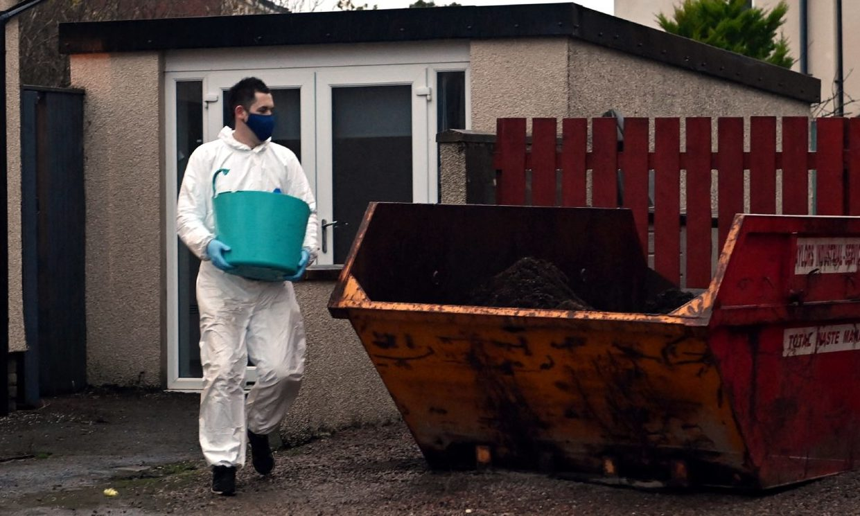Bags and buckets of soil were taken from the Aberdeen property following a drugs raid.