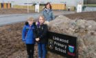 Linkwood Primary School head teacher Fiona Stevenson with P3 pupil William Forbes and P2 pupil Louise Buchan.