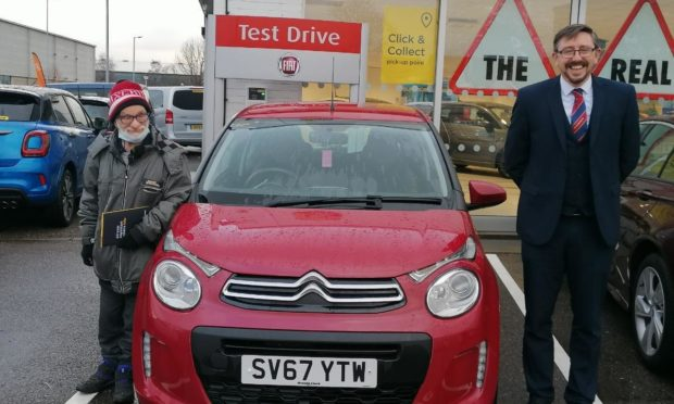 Maurice Dey and Stuart Rourke, the manager at Arnold Clark with car bought thanks to the fundraiser.