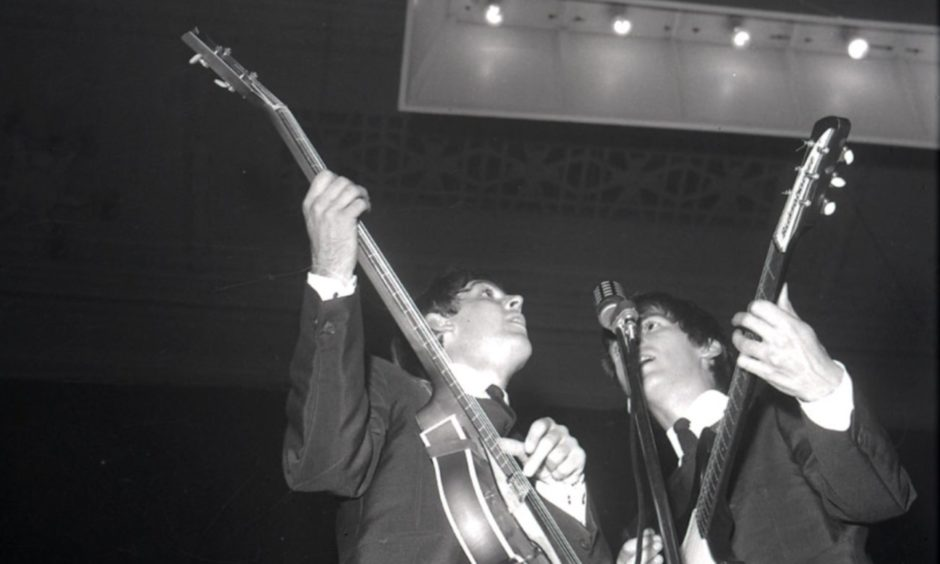 Paul McCartney and George Harrison on stage in Dundee.