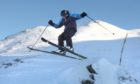 Kris Miller, Courier, News, 06/01/11. Picture today at Glenshee shows skier Ian Boswell enjoying the fantastic conditions in winter sun.