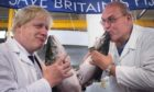 Boris Johnson kisses a salmon on the Brexit campaign trail