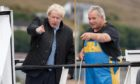 Boris Johnson points out the lost city of gold to skipper Ronnie Norquoy. Maybe.