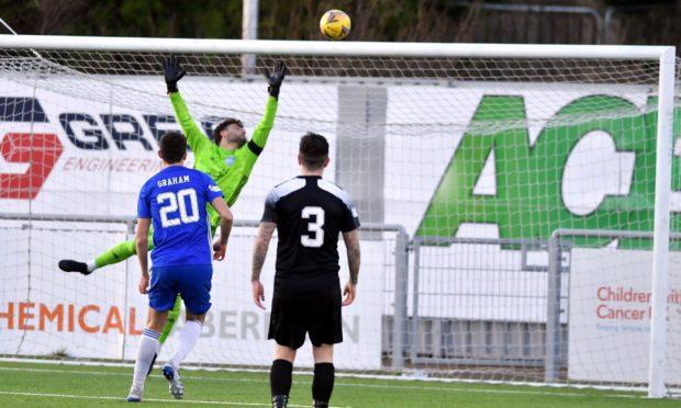 Rory McAllister's header loops over Peterhead goalkeeper Josh Rae.
