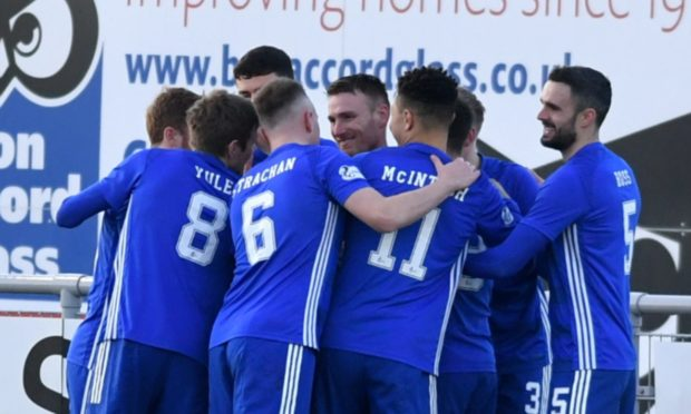 Cove Rangers players congratulate Rory McAllister.