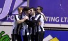Fraserburgh players celebrate their equaliser against Banks o' Dee in the Scottish Cup