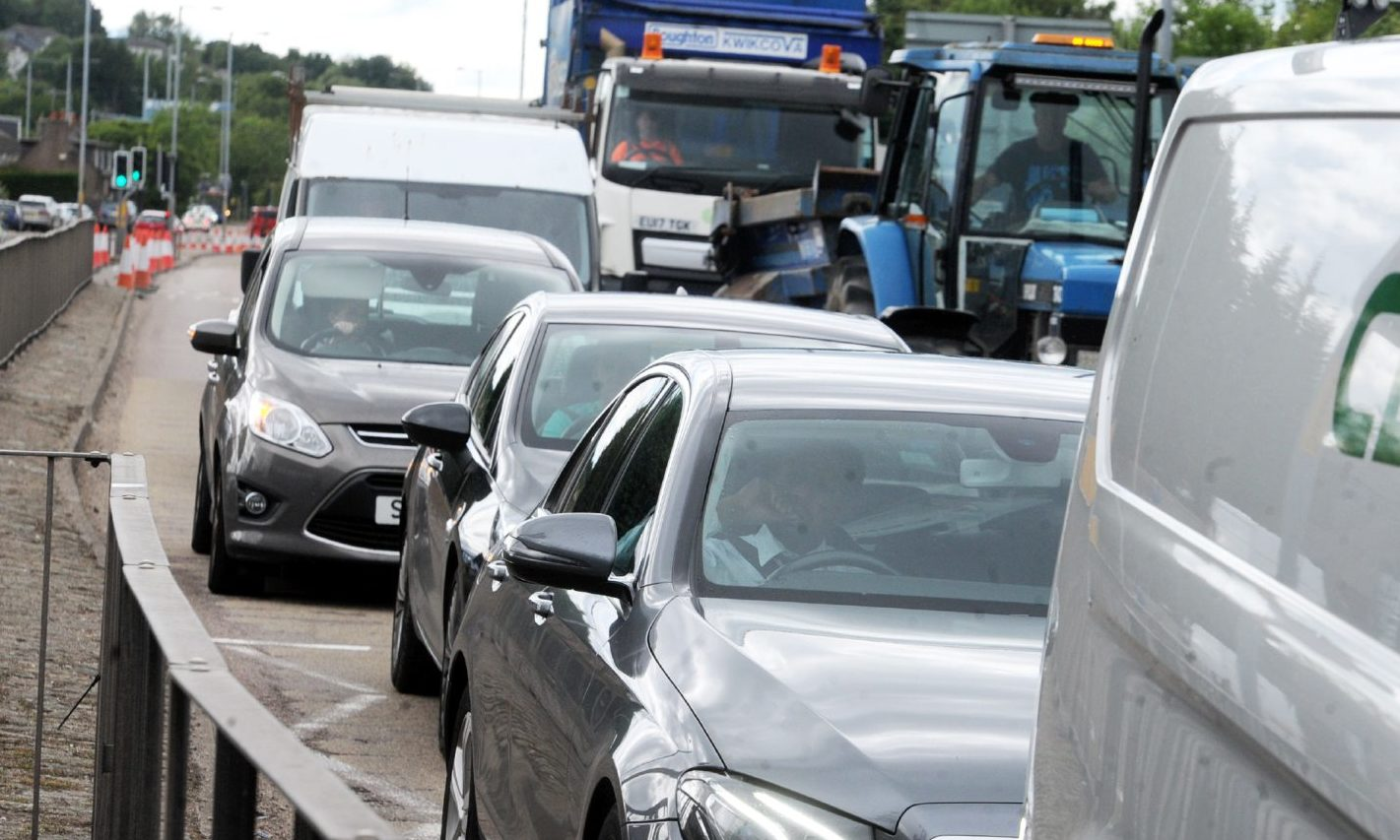 Traffic queued at the Haudagain roundabout, where work has been delayed.