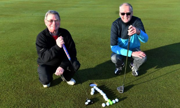 From left, Neil Birnie and George Connon, who both aced the ninth hole on the St Olaf Course at Cruden Bay. Picture by Chris Sumner