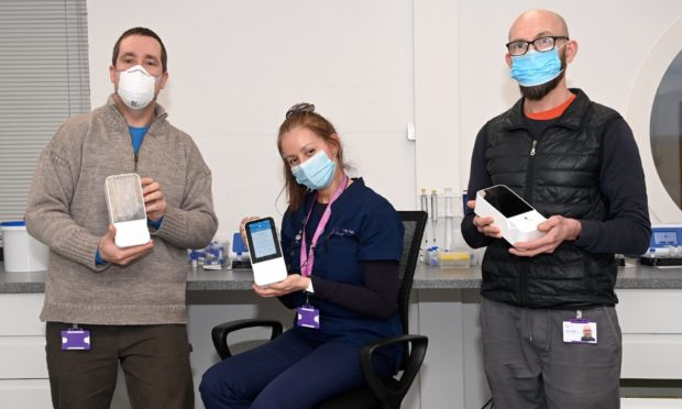 Pictured are from left, Kieran Gullett, Liliana Chaparro and David Leiper of TAC Healthcare Group with their new Lumira Dx testing kits which are used for Covid testing offshore.